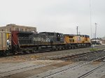 SP 343 UP 5957  1Apr2011  EB with empty coal cars approaching the yard office 